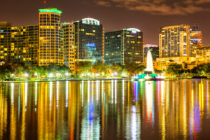 Orlando downtown skyline panorama over Lake Eola at night with urban skyscrapers. RM